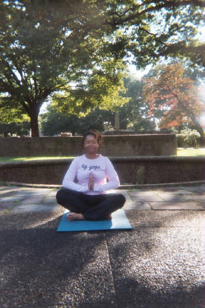 Practicing yoga in Malcolm X-Meridian Hall Park