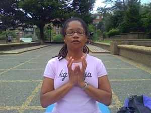 Ananda practicing the lotus mudra