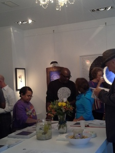 Victor Ekpuk chatting with people at Morton Fine Art exhibition on 9/13