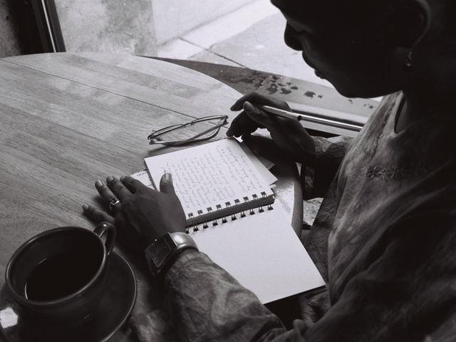 Ananda writing in her journal at Love Café on U Street in DC in 2004