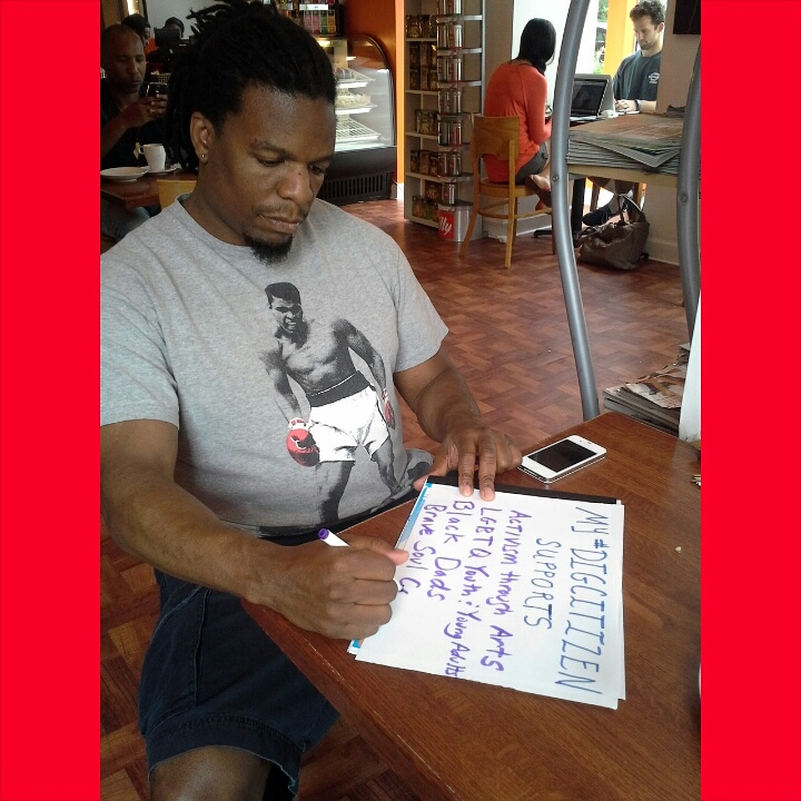 Tim'm West making his My #DigCitizen Supports sign at Azi's Café in DC